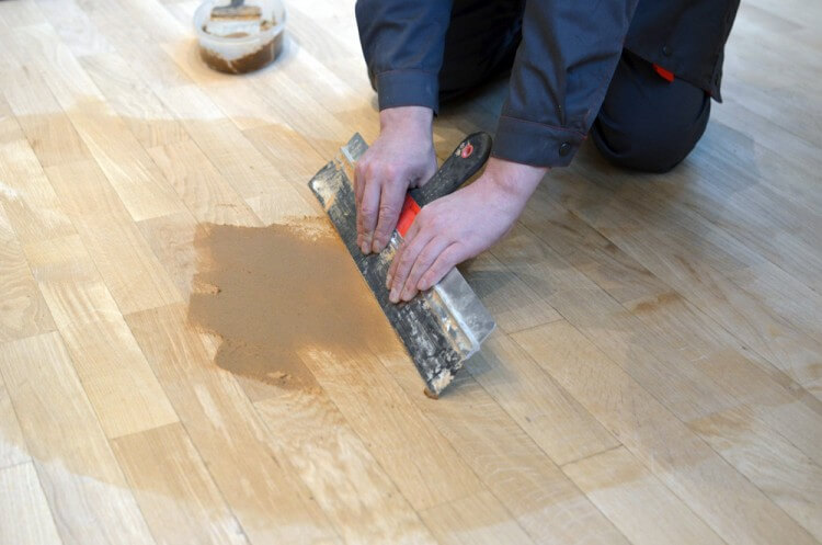 applying putty to wooden floors - How To Sand A Wooden Floor: DIY Guide