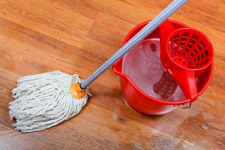 mopping up wooden floor - How To Sand A Wooden Floor: DIY Guide